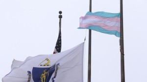 The trans flag flying over Boston City Hall Plaza